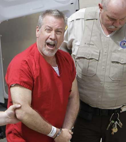 FILE - In this May 8, 2009 file photo, former Bolingbrook, Ill., police sergeant Drew Peterson yells to reporters as he arrives at the Will County Courthouse in Joliet, Ill.  <span class=meta>(AP Photo&#47;M. Spencer Green, File)</span>